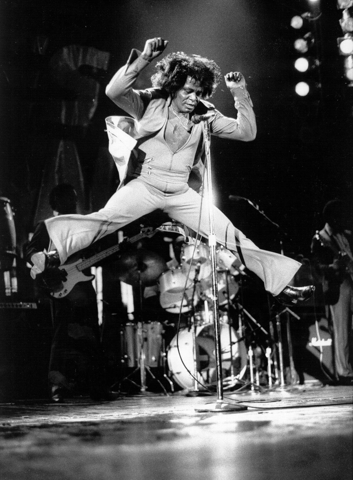 James Brown, the father of funk, leaps high in an onstage performance. Let his innovations inspire you to get out of your tarot funk and back into your groove.