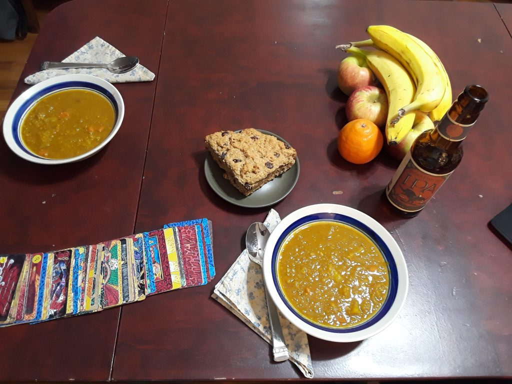 Two bowls of curried butternut squash, red lentil, and apple soup bring to mind the 2 of Cups tarot card.