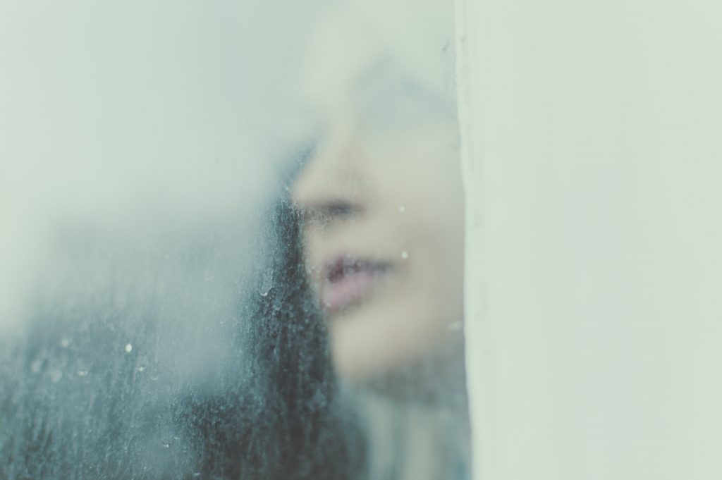 A woman's face is obscured by a rain streaked window. She can't see clearly. Sometimes when we work with the tarot we need something but don't know what. Want to do a tarot reading but don't know what to ask? Look no further. Here are fifteen tarot questions to ask when you don't have a question.