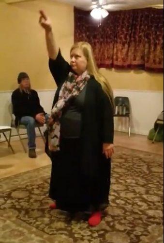 Joy demonstrating the Lesser Banishing Ritual of the Pentagram.