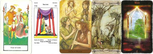 Four of Wands cards from various decks