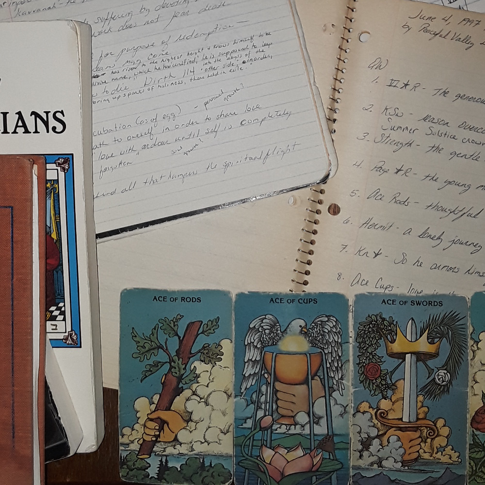 Books, notebooks, and tarot cards that I've used for daily tarot practice.