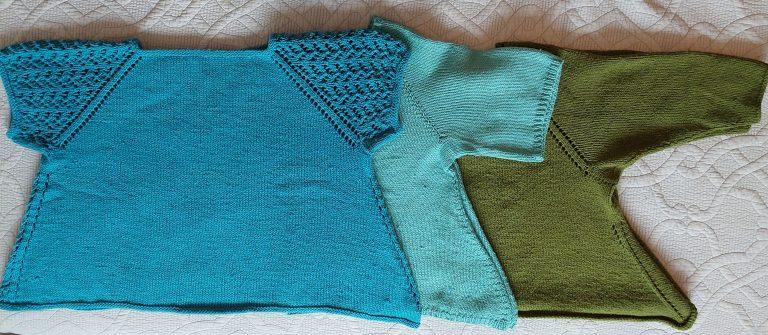 Three sweaters: dark green, light teal, and medium teal